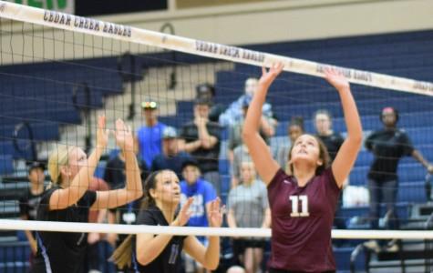 Senior Zoe Zamora set the ball for her teammate against Cedar Creek Sept. 10.