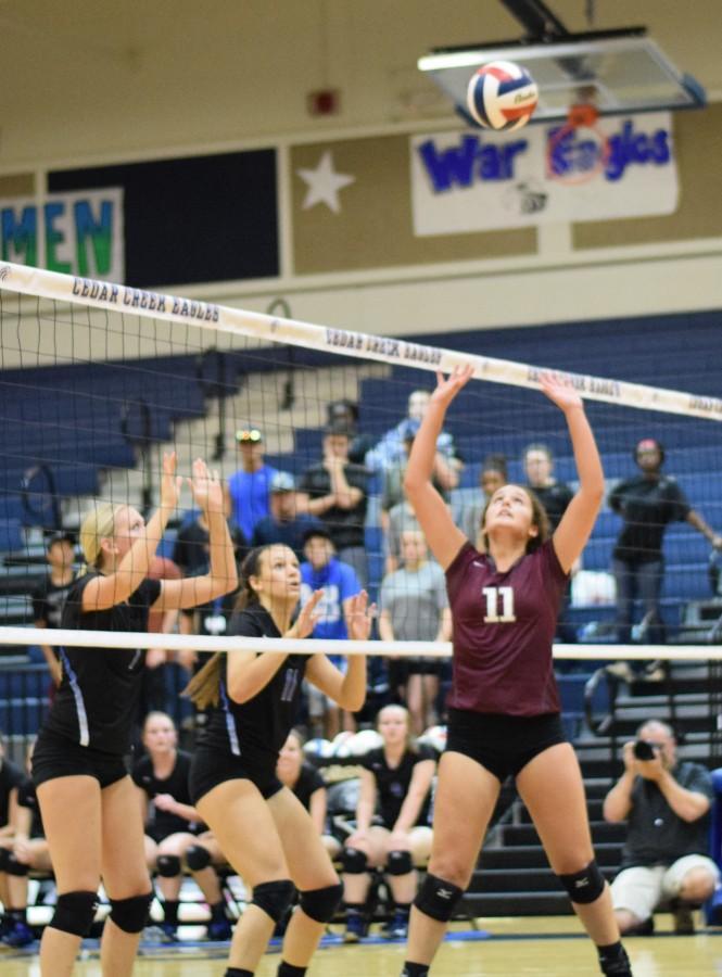 Senior+Zoe+Zamora+set+the+ball+for+her+teammate+against+Cedar+Creek+Sept.+10.