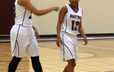 Kya Tarver and Brianna Lester discuss strategy as they walk onto the court.