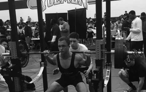 With deep concentration, senior Brandon Batot squats 395 pounds during the intense powerlifing tournament at Yoe High School where he placed 2nd and his team placed 3rd overall.