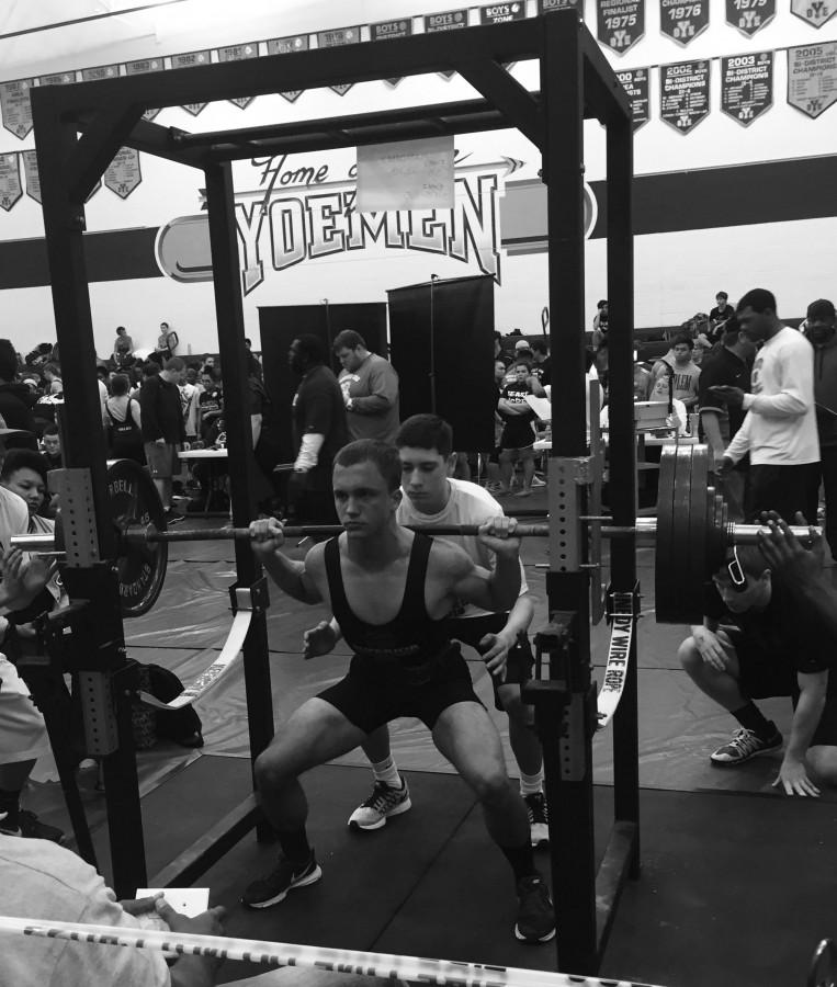 With+deep+concentration%2C+senior+Brandon+Batot+squats+395+pounds+during+the+intense+powerlifing+tournament+at+Yoe+High+School+where+he+placed+2nd+and+his+team+placed+3rd+overall.