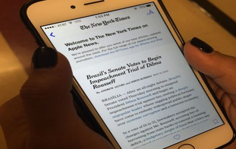 With her recently updated iPhone, Amanda Hendrix browses through the New York Times on the news app. The news app keeps readers up to speed on the biggest stories to date.