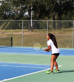 Senior Malee Martinez gets ready to return a serve against Cedar Creek at Cedar Creek high school on October 1.