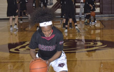 Bringing her A game, junior Breanna Lester sports her Adidas basketball gear  during a game against Rouse on Dec. 6. The Lady Bears defeated Rouse 38 to 34.