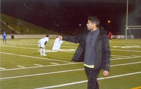 Soccer coach Dennis Teuber directs the Robert E Lee High School boys (2015-16) as they defeat the Lakeview Centennial High School Patriots. Teuber tells his players to get back on defense as the other teams tries to run their offensive play.