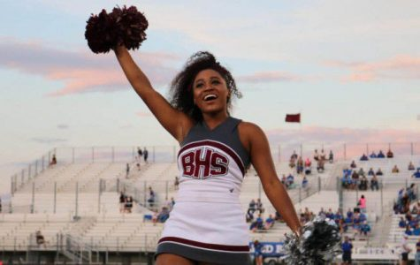 During football games cheer captain Dasheanna  Shaw displays a bright smile to show her love for the Bears.
