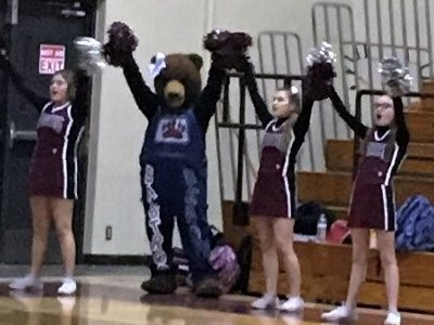 Mascot Paige Barrington cheers alongside the cheerleaders at the JV girls basketball game against East View Jan. 10.