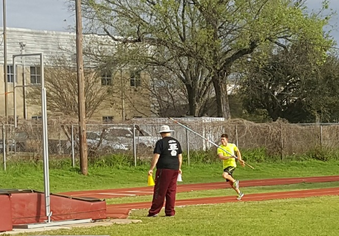Sophomore Sutton Lindsley practices pole vaulting for the win at Erhard field on March 8.
