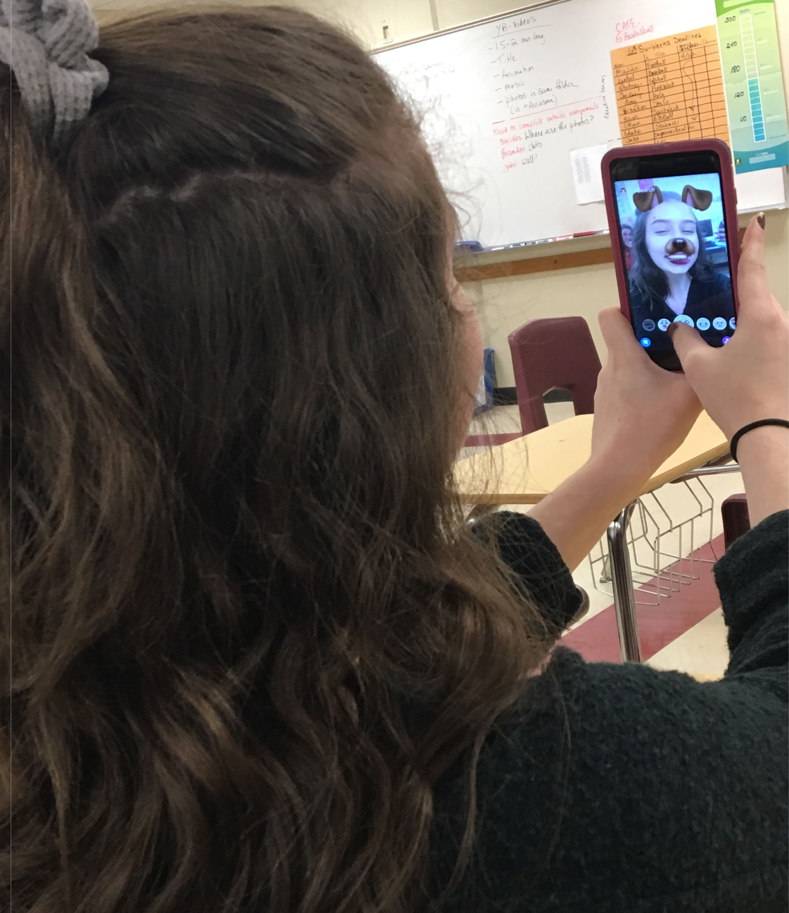 Junior Zoe Picciandra indulges in her cell phone once she arrives at her class.