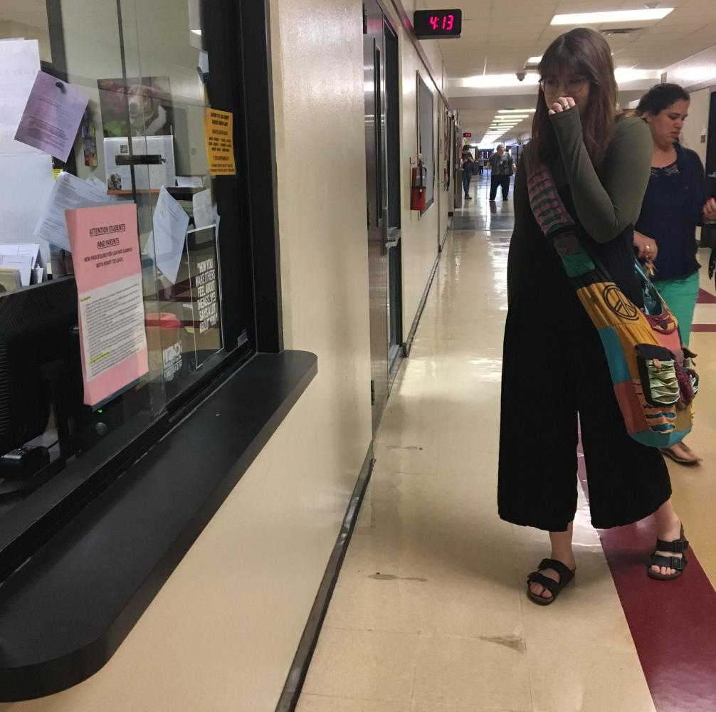 "Sophomore Makenzie Clawson turns in her excuse letter after school so she can be excused for the day she missed. ""We need more days to miss. It's not fair,"" Clawson said."
