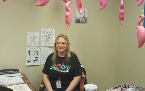 Instructional coach Amanda Hudspeth is surprised to find her office flocked on April 13. The flamingos stay in each room for one day as a fundraiser for the PALS Relay for life team.