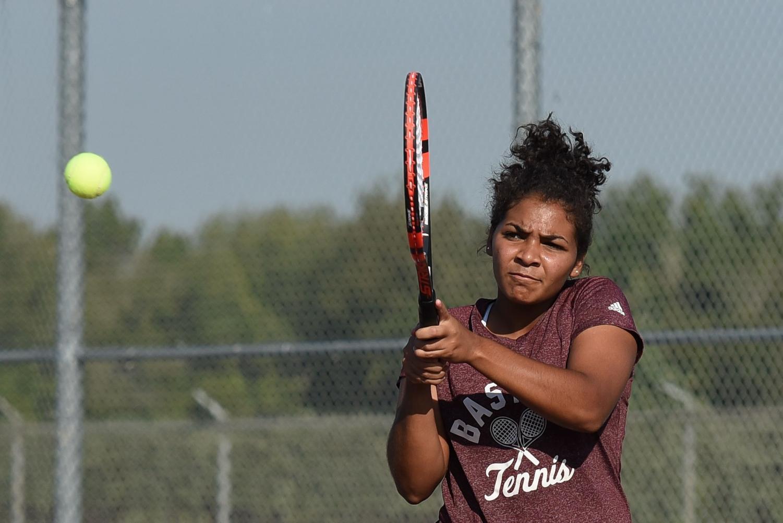 Elexa Ashby hitting a ball to get match point