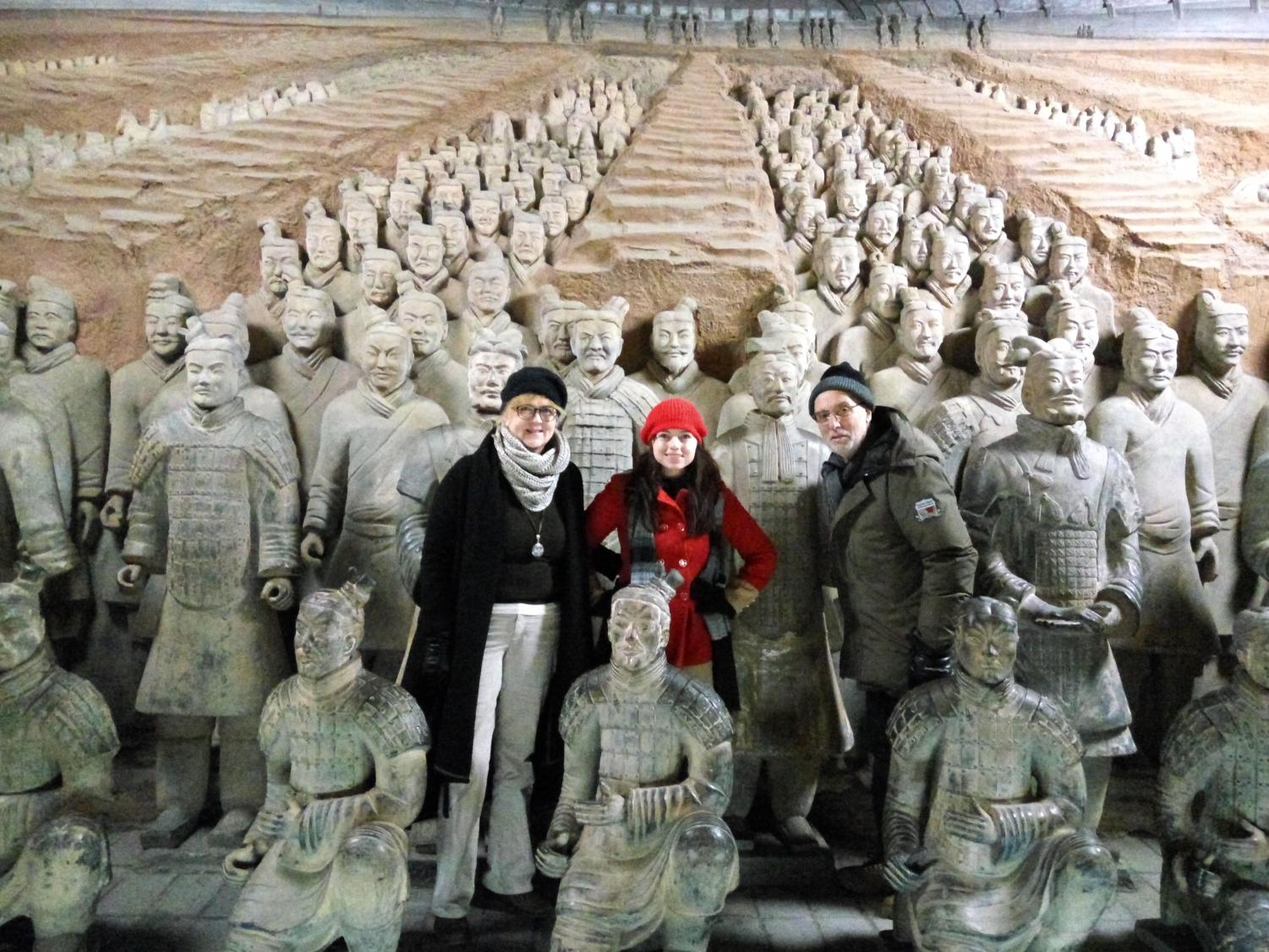 Theresa Zinda takes a picture with her husband and daughter in front of the Terracotta soldiers in Beijing, China.