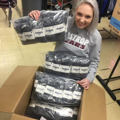 "Helping the community, teacher Emily Clark works with a company, Bombas to provide 250 pairs of socks to BHS' Christian's Closet. Bombas is a high quality sock brand that shares the message ""bee better"". A bumble bee symbol can be found on each sock to represent the message the company stands behind."