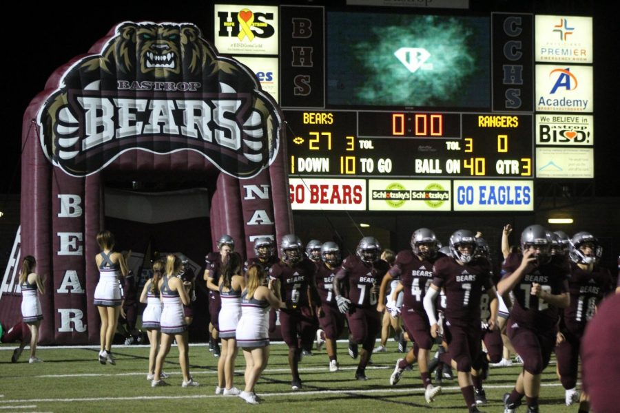 The+varsity+football+team+arrives+back+on+the+field+after+a+short+halftime+against+Rudder+High+School+located+in+Bryan%2C+Texas.+The+final+score+was+Bastrop+36-+Rudder+14.