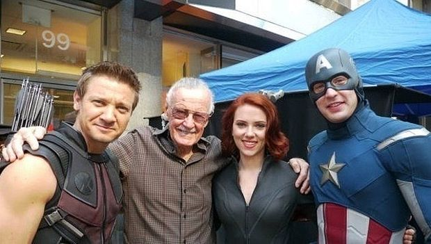Stan Lee poses with actors Jeremey Renner, Scarlett Johansson, and Chris Evans who have brought the Marvel comic characters to life.