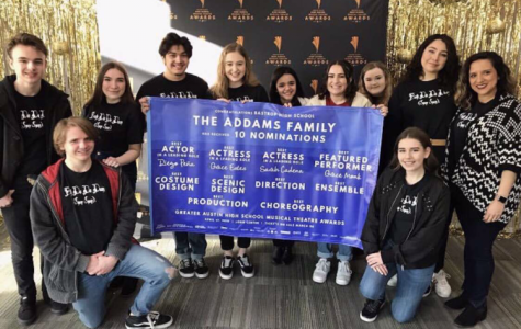 Members of the Addams Family cast and crew pose with their GAHSMTA banner after learning what awards they had been nominated for.