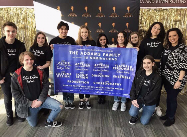 Members+of+the+Addams+Family+cast+and+crew+pose+with+their+GAHSMTA+banner+after+learning+what+awards+they+had+been+nominated+for.