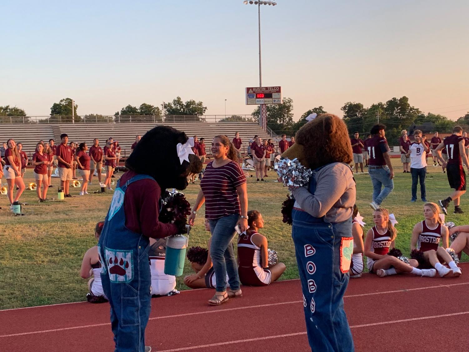 JV Mascot, Billie the Bear, mimics the poses of Varsity and Senior Mascot, Bobby the Bear, at Meet the Bears town pep rally on August 16 at Erhard Field.