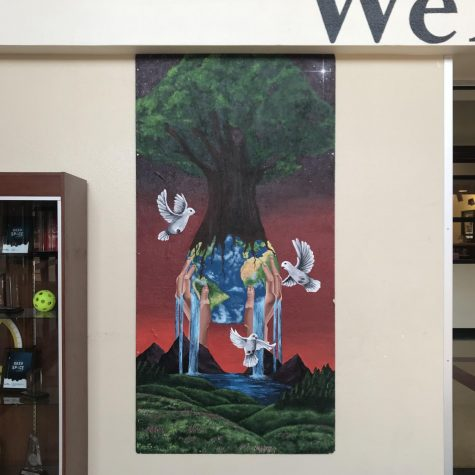 The 2018-19 school year Earth Day art mural hangs in the foyer for all students, staff, and visitors to admire.