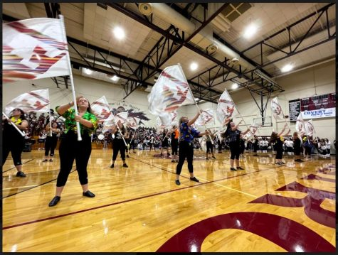 The Color guard performs a portion of the halftime show in the gym during the first pep rally of the school year.